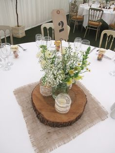 Rustic Marquee Wedding - Sweetpea and Ivy log slice centrepiece jam jars lace hessian