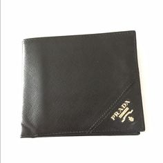 Prada Men's Bifold Wallet Authentic Prada. Excellent condition. Black leather with silver Prada emblem on front. Prada Bags Wallets