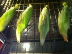 corn in oven - unshucked, layed right on the rack, 350º for 30 minutes, let sit a few minutes, shuck, and eat!  If you want, you can cut off stem end & shake it out of the husk like you do when you cook it in the microwave so no shucking involved!