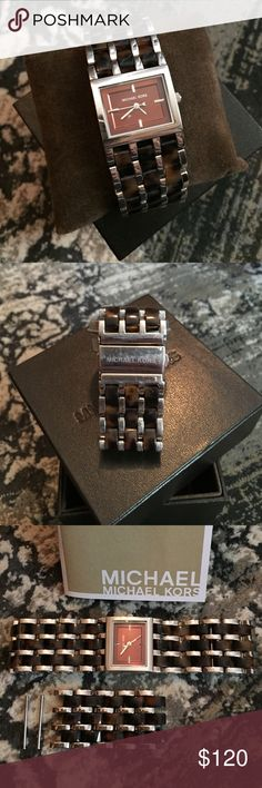 Michael Kors Ladies Watch Beautiful stainless steel and Tortoise watch by Michael Kors. Brown square face (25mm wide x 22mm tall) with silver hands. Gently worn but has some signs of wear on the stainless steel, mostly on the clasp (superficial scratches from normal wear). Michael Kors Accessories Watches