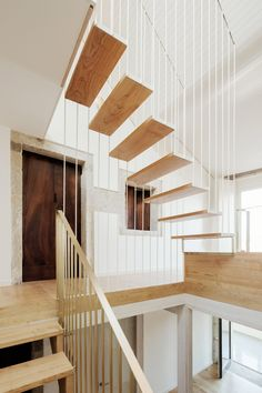 Staircase connecting all four levels of a renovated Spanish townhouse