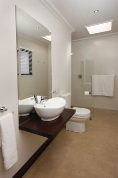 Spacious bathrooms in the Deluxe rooms.  the floors are a mix or cement, sand and crushed sea shells.