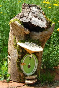 This enchanted fairy house was lovingly made by me from a fallen hollowed tree found in our Wisconsin forest. The bark had fallen away long ago