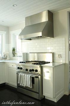 kitchens - subway tiles backsplash greige walls white beadboard ceiling white kitchen cabinets marble tops White beadboard ceiling, greige walls