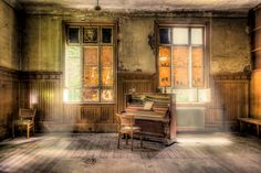 ghost piano brandfree edit - an old piano left in the ruins of a former house