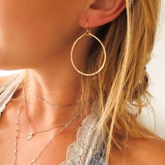 Gold Hoop Earrings / Good People Wear Hoops 14K by delialangan, $27.00 Love that these hang down in circles instead of coming through the ear.