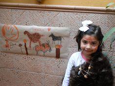 Animación infantil ambientada en la Prehistoria. Caracterización y realización de mural imitando la pintura rupestre.