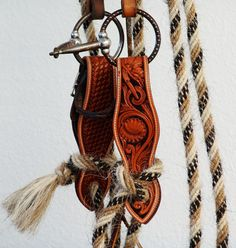 Tooled Slobber Straps. The Mecate (braided horse hair or rope) is used as the reins and tied to the slobber straps as a functional piece of art in this example.