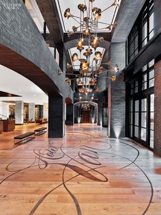 The hotel name appears stenciled on the entry's white-oak floor.Photography by Eric Laignel.