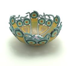 """Emily Squires Levine, """"I translate my love of color and pattern into vessels of many sizes and shapes, exploiting the versatility of polymer clay."""" - Med/lg bowl, 2 inches tall x 5 inches diameter."""