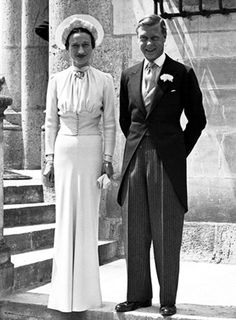 Edward VIII abdicated his throne in December 1936 in order to marry Wallis Simpson. They were married in June 1937 at the Château de Candé in France. She wore a pale blue dress with a nipped-in buttoned waist, a Cartier brooch at her neck and a halo-like hat.