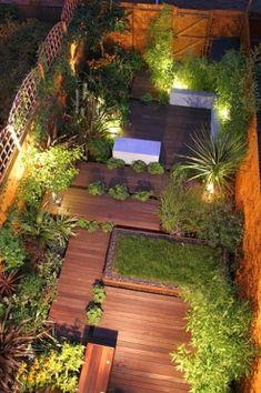 Nice design of small garden space. Great lighting helps.