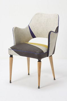 new found chair love: Draga Obradovic reupholstered the chair in coated-cotton canvas fabric; stunning