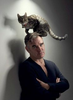 Morrissey with a cat on his head.