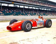 A young Bobby Unser driving an STP Novi