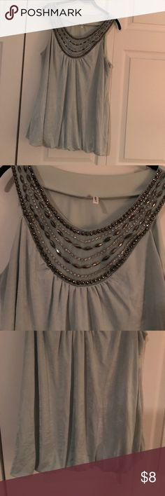 Light cream beaded tank Maurices light green size large beaded tank top . There are a couple tiny threads sticking out but can't even notice (see pic) material almost has a shiny look to it. Maurices Tops Tank Tops