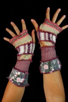 Here is a great pair of arm warmers made from bits of recycled knits. They have a sweet palette of delicate colors. Enjoy!
