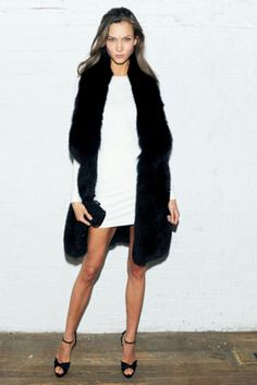 White Long Sleeve Dress with a Long Black Gilet to keep warm.