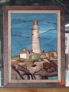 Boston Light. The lighthouse and rocks are done in wood with the sky and water being stained glass.
