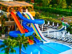 #chair #color #entertainment #fun #hotel #leisure #outdoors #park #play #playground #pool #recreation #relaxation #resort #slide #slides #summer #tilt shift #toy #travel #vacation