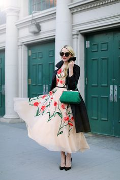 Blair Eadie of Atlantic-Pacific blog wearing a Lela Rose dress to day four of NYFW.