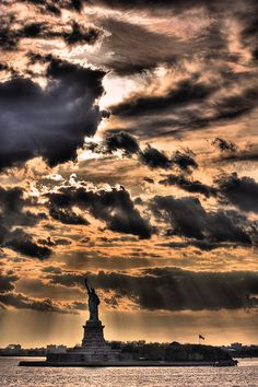 Sun Rays around Statue of Liberty, New York City