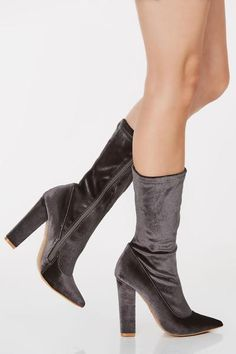 Velvet finish point toe boots. Mid-calf rise with side zip closure.