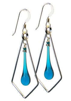 These geometric sterling silver and turquoise blue earrings are a real attention grabber, standing out in any hairstyle.