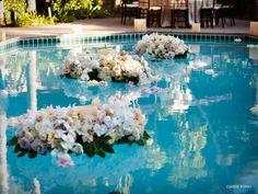 Great idea to float flowers in the pool at the reception!