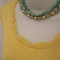 Rise & Shine Top Jones New York Collection Jones New York collection sunshine yellow knit sleeveless sweater. This sleeveless shell classic is made fun with a peek a boo ruffled detail at neckline. A classic silhouette in a punch of color!  53% linen 46% viscose 1% other fibers  Hand wash  Like new Jones New York Sweaters Crew & Scoop Necks