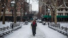A woman walks through Washington Square Park after a snowstorm on the morning of Feb. 17, 2015 in New York City. The city received approximately 3-6 inches of snow overnight.