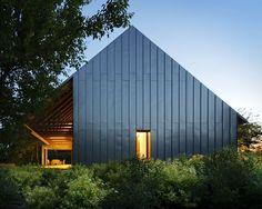 Gabled farmhouse by architectsBudapesti Műhely. A contemporary interpretation of a traditional Hungarian peasant house.