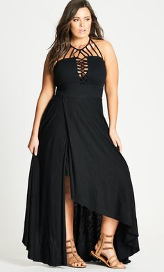 Bring a little sexy when you go from beach to bar with the Plait Detail Maxi Dress. Key Features Include: - Halter neck with strapping feature - Lace up front - Fitted waistband - Knee length skirt with full length over wrap over layer - Elasticated back panel for comfort and fit - Back neck tie with gold bead trim - Pull-on style