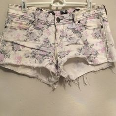 White Floral Cutoff Shorts Absolutely love these white floral cutoff shorts. They're size 7 junior, but fit like a size 2-4 in non-junior sizing. They have some stretch that make them comfy yet cute. 98% cotton, 2% spandex. Shorts