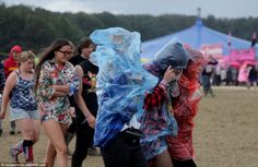 After a mild start to the day, wind and rain hit Bramham Park on Saturday afternoon, soaki. Wind And Rain, Enjoy The Sunshine, Music Festivals, Cowboy Hats, Park, Tops, Fashion, Moda, Fashion Styles