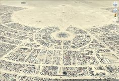We've discussed the famous Burning Man event quite a few times in the past (2011, 2010, 2007, 2006) as Google often features aerial imagery from the event in Google Earth.  In fact, by using the historical imagery feature in the Black Rock, NV area you can find imagery from many of their events over the past few years.