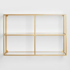 With an open design, a brass metal frame and two natural wood shelves, our wall shelf exudes a mid-century modern air. Glass Wall Shelves, Wall Mounted Shelves, Wall Shelves, Floating Glass Shelves, Glass Shelves Kitchen, Glass Shelves Decor, Glass Shelf Brackets, Gold Shelves, Shelving