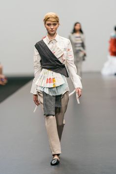 Layered up-cycled top and reconstructed tailored camel trousers, made from secondhand clothing and textile swatches, embellished with paper receipts. Design by Joëlle van de Pavert  #ECDA #JoëllevandePavert #sustainablefashion #upcycle #reconstruction