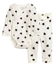 Check this out! CONSCIOUS. Set in soft, organic cotton jersey with a printed pattern. Long-sleeved, wrap-front bodysuit with snap fasteners at one side and at gusset. Pants with wide, foldover ribbing at waist and ribbed hems. - Visit hm.com to see more.