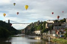 Somerset: Hot air balloons over the Clifton Suspension Bridge and Avon Gorge at Bristol, UK.  Photo by Katherine Ross.  Every year, around the 12th-ish of August the Bristol International Balloon Fiesta is held at Ashton Court, just outside the city.  (Festival scheduled for 9-12th Aug, 2012 - check the official site for further details:  http://www.bristolballoonfiesta.co.uk/