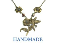 "Use code SOCIAL15 for 15% off all purchases over $15, plus FREE shipping on most jewelry! Hummingbird necklace handmade, antiqued bronze flower with hummingbird, red floral cloisonne beads and antiqued bronze flower links.  It measures 20"" (50.8 cm)   ► To see m... #etsygifts #vintage #vjse2 #jewelry #gift ➡️ http://jto.li/22sJj"