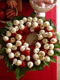 I think it is Mozzarella balls,  cherry     tomatoes,  and basil leafs