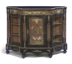 A VICTORIAN GILT-METAL MOUNTED EBONIZED, SCARLET TORTOISESHELL AND METAL INLAID CREDENZA SECOND HALF 19TH CENTURY  Of small proportions and shaped breakfront outline, the central cabinet door flanked by two serpentine glazed cupboards to each end.