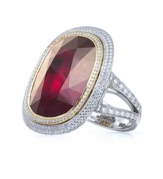 A marvellous, important cluster ring from Boodles, featuring a stunning ruby of 25.16ct and a further 2.36ct of round-brilliant cut diamonds in platinum.