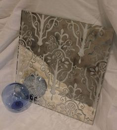 Looking for something unique that can be done on antique mirror glass? The picture below has a damask pattern etched into the back and then has been clearcoated to allow light to pass through.