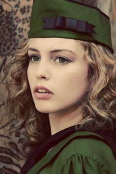 Dieselpunk Military Hat with Bow  Army Green Vintage Style WWII Flight Cap Garrison Hat Wedge Cap Womens Medium. 29.95, via Etsy.