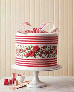Inside of this ikat and French silk ribbon cake, alternating layers of red velvet cake and white buttercream echo the ribbon's stripes (we stacked two of these five-layer tiers).