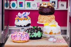 Giant Chocolate & Vanilla Donut Cakes Piled High with Delish Toppings! – HOW TO CAKE IT