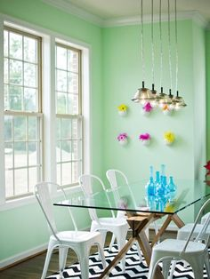 Colors choice and glass make the space feel light and airy for how small it probably is.