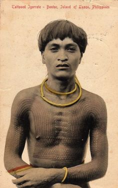 young male of jgorrte tribe | island of luzon, phillipines | 1908 | tribal tattoo + jewelry